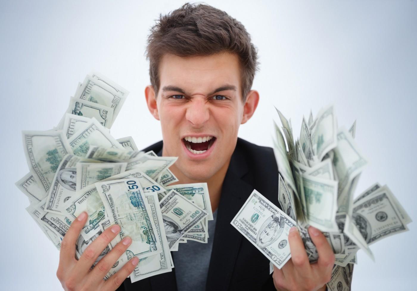 Closeup of a young business man holding money - Kasprzaka 29